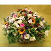 Seasonal mixed flower basket arrangement
