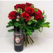 Bunch of red roses with bottle of wine